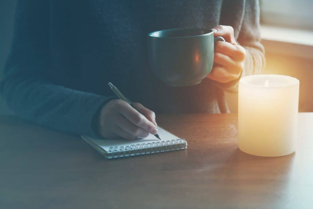 Women over 50 journaling as part of daily morning routine